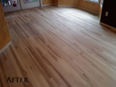Pulled carpet, laced in new Hickory flooring