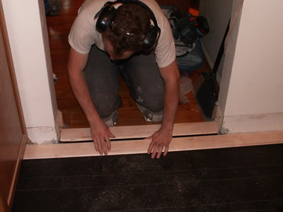 Mike Stalkfleet installing a rustic (third grade) maple floor in a kitchen
